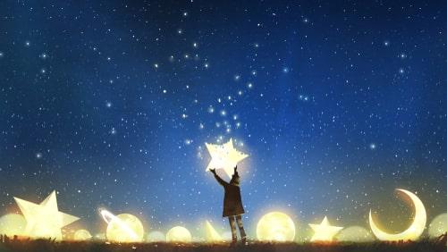 人が星を飾っている様子